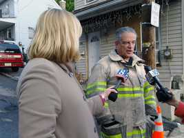 News 8's Anne Shannon interviews a fire official.
