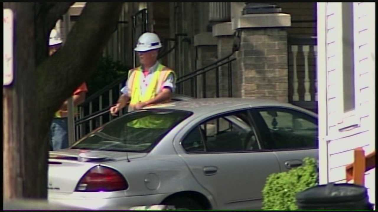 A car slams into a gas line, breaking it open and forcing a neighborhood evacuation in Lancaster on Tuesday afternoon.