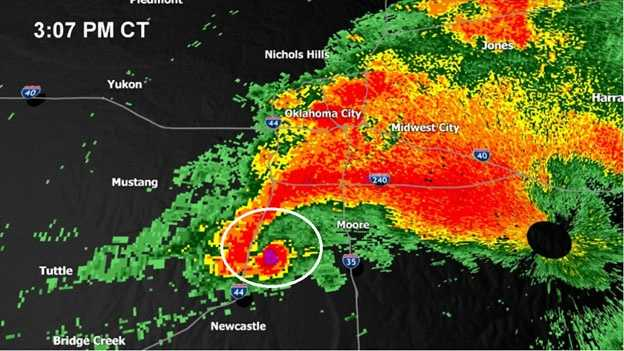 """The classic """"hook echo,"""" which meteorologists look for to identify a tornado on radar, is circled."""
