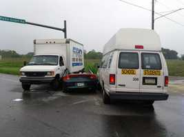 A box truck, a school van with no students on board and a car were involved.