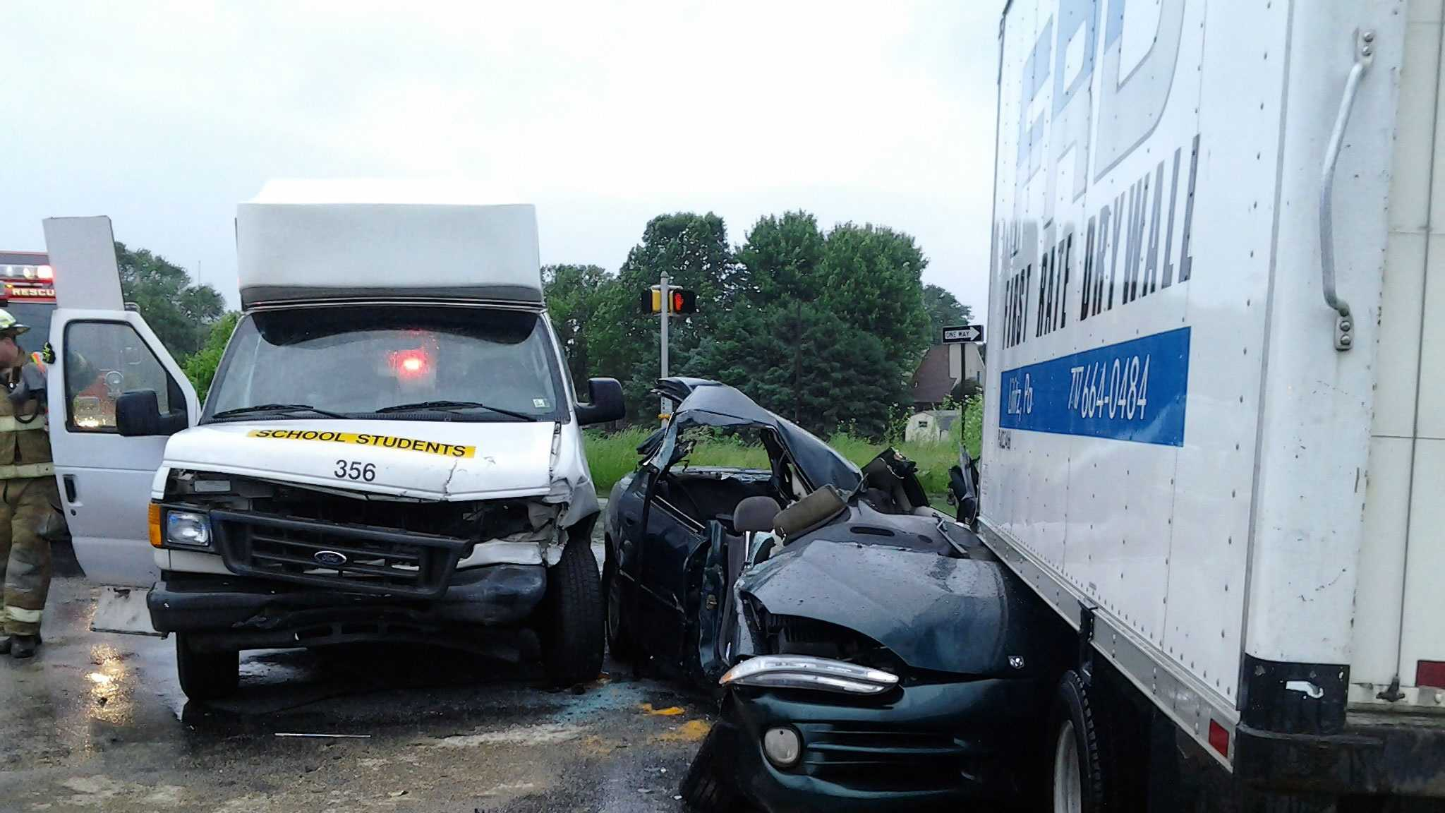 A woman in the car and the truck driver were taken to a hospital.