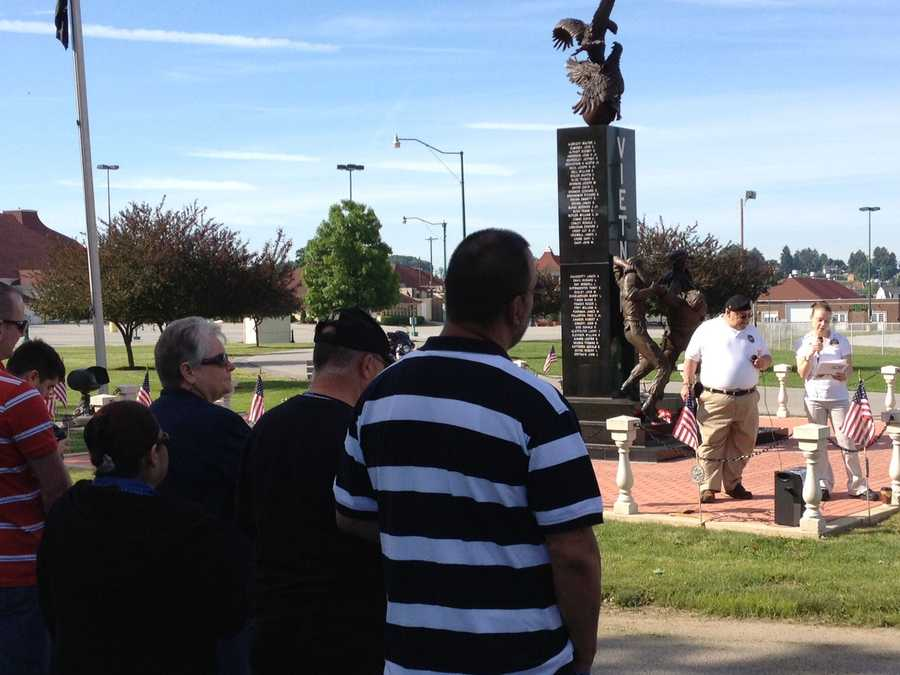 People gather at the Vietnam veterans memorial at the York fairgrounds for a Memorial Day ceremony.
