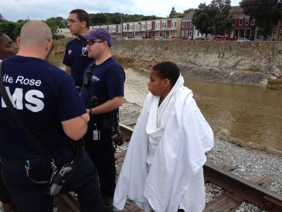 Rescuers set up along the bank and pulled the boys, Michael Jeffers, 12, and Nate Jeffers, 13, to shore.