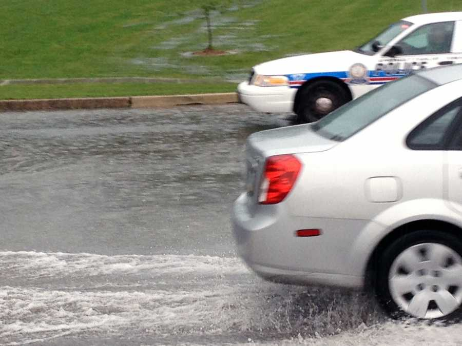Several cars drove through the water while News 8's Ed Weinstock took these photos.