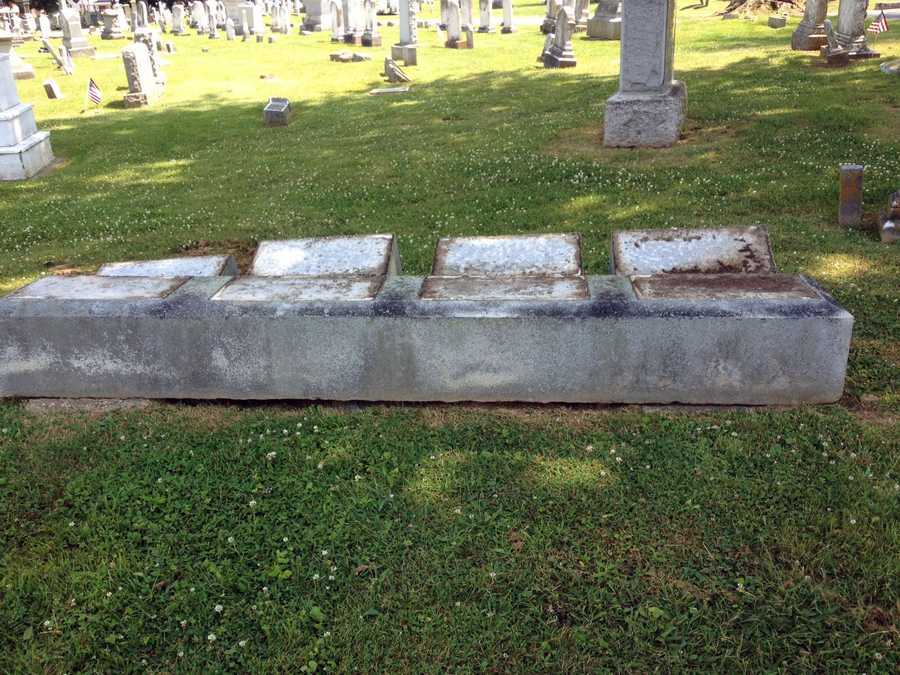 The 19th century gravestones were knocked over after 3 p.m. Monday.