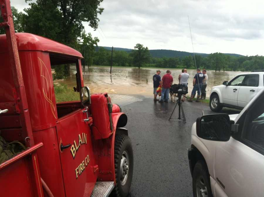 Rescuers were trying to get to a stranded car on the roadway.