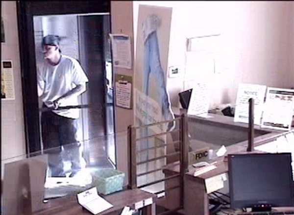 This surveillance image shows a man walking into a Lebanon County bank Tuesday morning, moments before he robs it, police say.