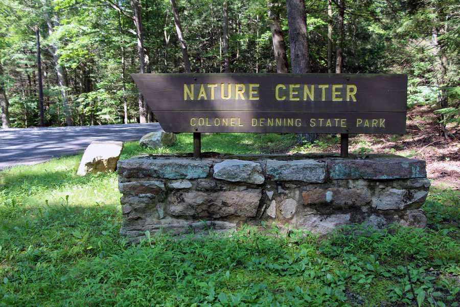 An environmental interpretor offers ecological and historical walks and programs ...