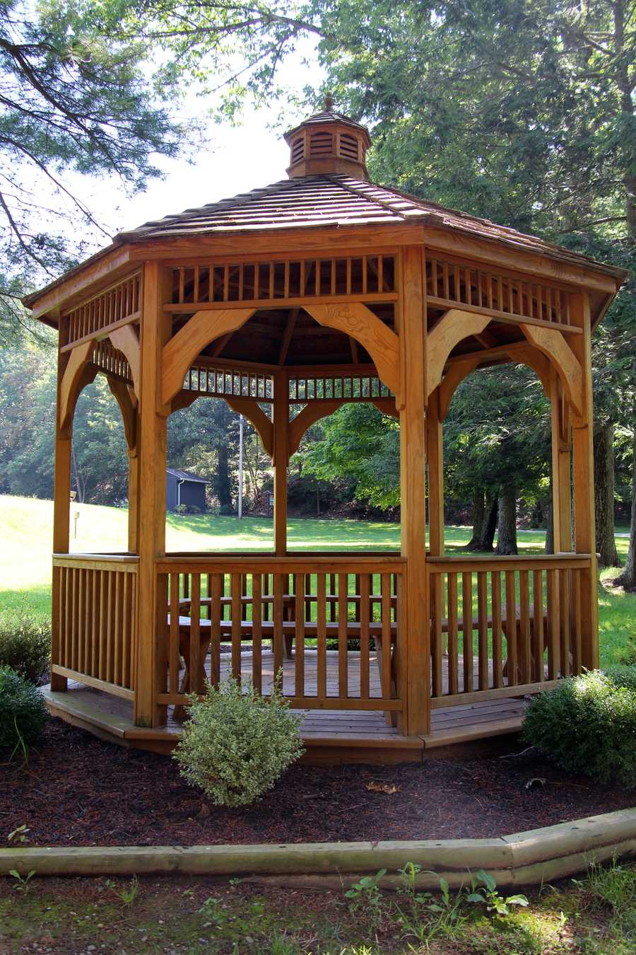 A gazebo is located near the spillway.
