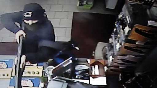 State police released this surveillance photo of the man accused in the robbery.