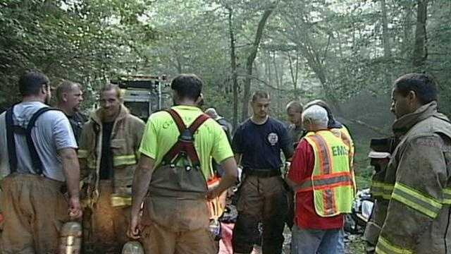 Officials said the house is located in a wooded area, making it difficult to fight the fire.