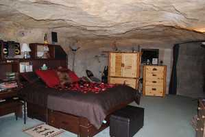 """Caving Inn: Kokopelli Cave Bed and Breakfast, Farmington, New Mexico. Located 70 feet below the ground near the Four Corners region of the U.S., this one guestroom bed and breakfast offers more than the average digs. Travelers are invited to experience the 1,650 square foot dwelling that boasts Southwestern style furniture and décor, a full kitchen, washer/dryer, and even a relaxing flagstone hot tub. """"This was a once in a lifetime experience! The cave is comfortable and has many homey touches,"""" commented a TripAdvisor traveler."""