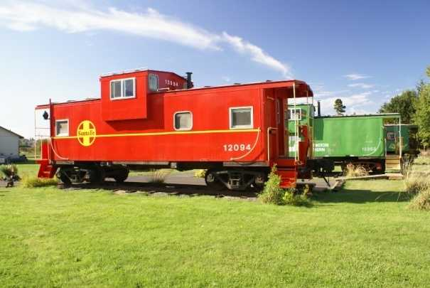 """Train Spotting: Red Caboose Getaway, Sequim, Washington. Located at the picturesque junction of the Olympic Mountains and the Dungeness River, this locomotive lodging offers spectacular scenery atop of tracks. Travelers can climb aboard six themed caboose cars refurbished with modern amenities including mini refrigerators, hot tubs, and a collection of train-travel movies, and later enjoy a gourmet meal at the """"Silver Eagle"""" zephyr dining car. """"The décor is charming, thoughtful, railroad-authentic, playful and well appointed,"""" commented a TripAdvisor traveler."""