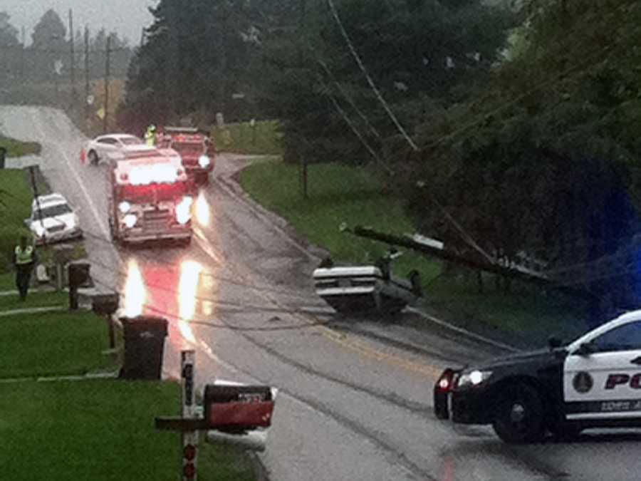 The car knocked down a utility pole.
