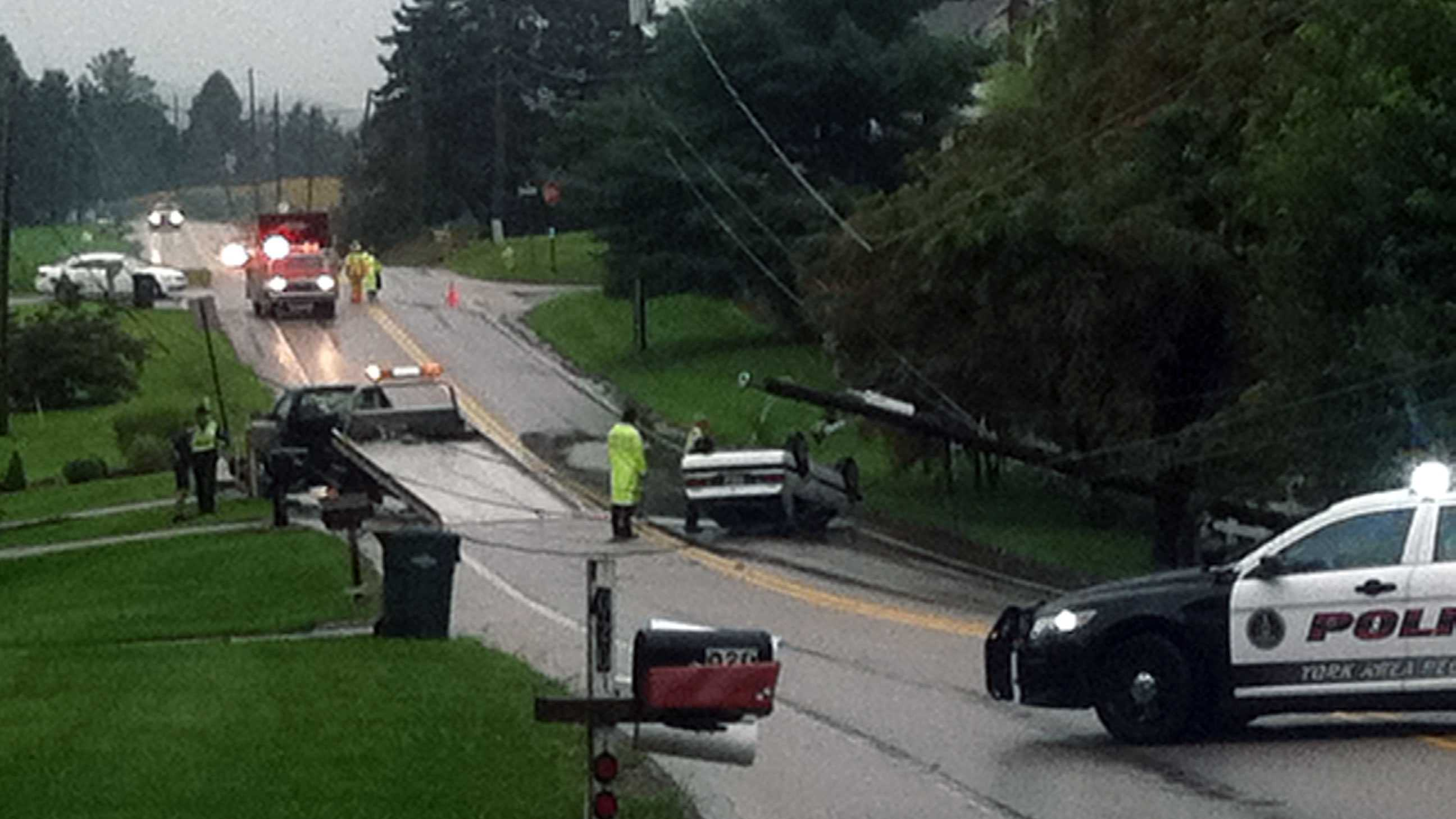A car flipped over Tuesday morning when it hit standing water along a road in Windsor Township,York County.
