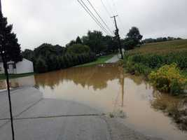 Woodberry Road in West Manchester Township, York County, is flooded.