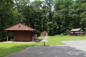 These facilities include dining halls, central washhouses, camper cabins and staff quarters.