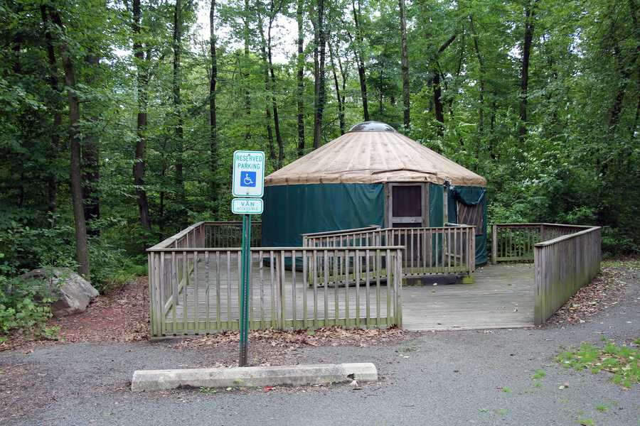 Two round, canvas and wood walled tents are on a wooden deck and sleep four people in two bunk beds. The Yurts have a cooking stove, microwave oven, refrigerator, countertop, table, chairs, electric heat and outlets as well as a fire ring and picnic table.