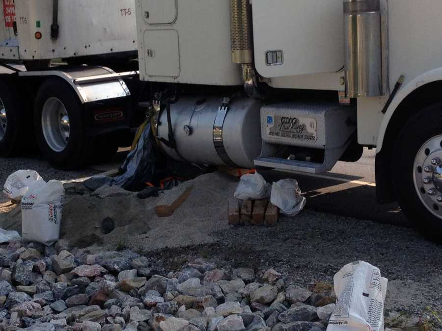 The truck hauling trash was crossing the intersection of East Prospect and Mount Pisgah roads when a diesel tank was punctured. The spill was contained.