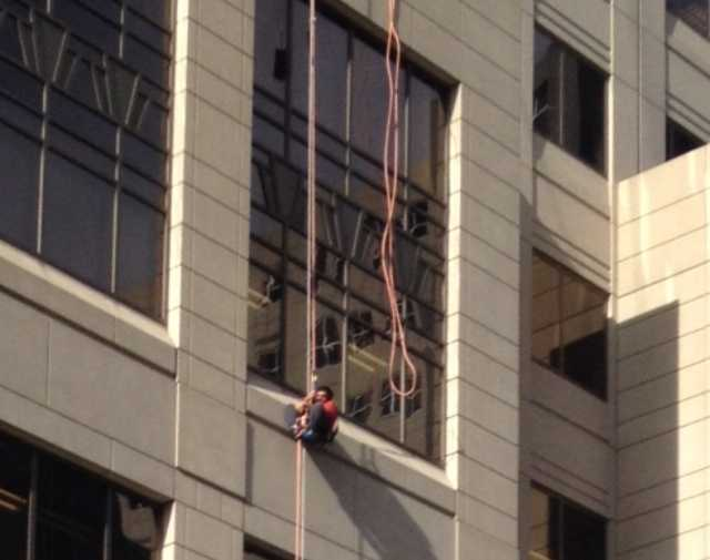 The man was working on the Penn National Insurance Building at 2nd and Market streets, when he became stuck in his gear. He was about 70 to 80 feet above the ground, according to Harrisburg Deputy Fire Chief Mike Horst.
