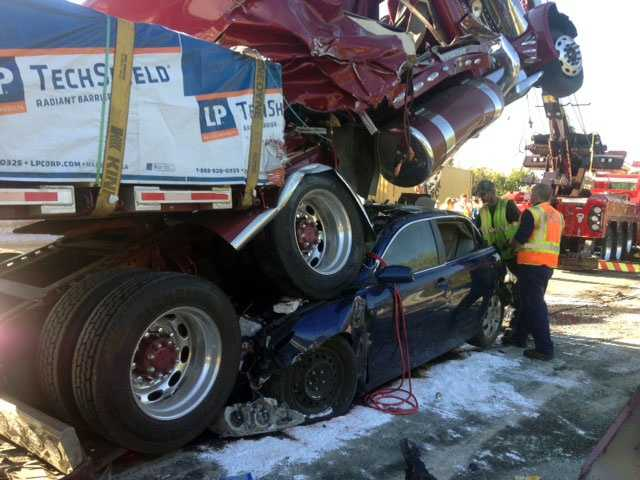 News 8's Ed Weinstock talked to the man who was driving the blue car pinned under the truck.