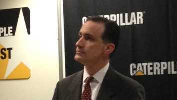 A Caterpillar official talks to the media at Monday's news conference.