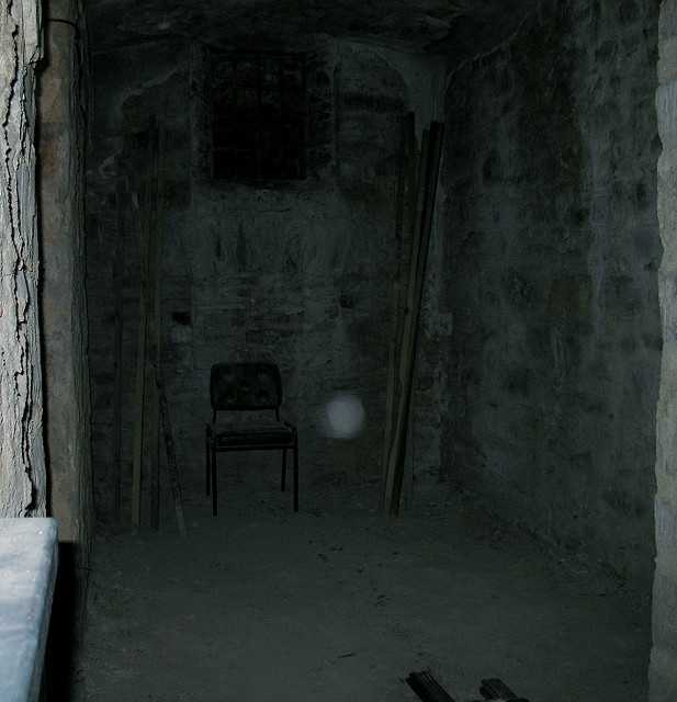 """16.Here's a very spooky room with an obvious orb. The photographer writes, """"I went 'out of bounds (no visitors beyond this point)' to take a shot of this room. I don't believe in ghosts, but i took two shots and it's on both! I think it's a stubborn air particle ,or maybe i should say hope? Bodmin Jail the spookiest place I've ever visited. It's in Cornwall England a great day out."""""""
