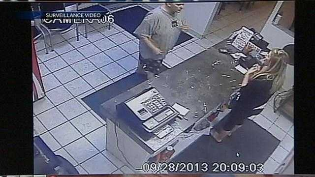 Jones went to Two cousins to confront the woman who sold her the dog. That woman works at the pizza shop (she is standing on the right).