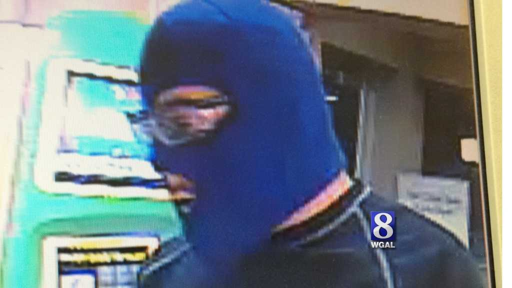 State police released this surveillance photo of the robbery suspect.