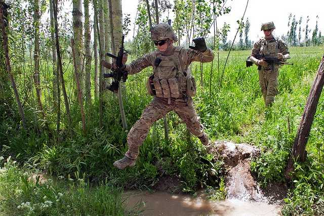 17. Staff Sgt. Ray Perez-Rosa, an infantryman with Troop C, 6th Squadron, 8th Cavalry Regiment, jumps over a water-filled ditch while on a foot patrol to counteract indirect fire near Combat Outpost Baraki Barak, May 21, 2013. Members of Troop C patrol conduct patrols in their continued effort to support the Afghan National Security Forces by putting unrelenting pressure on insurgents, helping to keep U.S. and Afghan soldiers and local civilians safe.