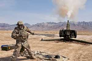 24. Sgt. 1st Class Fredrick Edwards fires a D-30 Howitzer at Kabul Military Training Center, Afghanistan, March 19, 2013. These test fires are the final step for this refurbished artillery weapon.