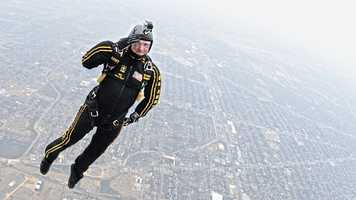 28. Sgt. 1st Class Aaron Figel, with the U.S. Army Golden Knights tandem team, salutes as he exits the aircraft over Stinson Airfield in San Antonio Jan. 3, 2013. The Golden Knights performed several jumps at the airfield and are part of military celebrations in conjunction with the U.S. Army All-American Bowl, scheduled to be held Jan. 5. The Army has hosted the event in San Antonio since 2002, selecting 90 of the top high school football players from across the nation to participate.