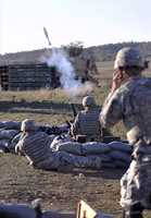 30. Spc. Thomas C. Marks, Reymond L. Kern and Austin, T. Chance, mortar men,2-2 Inf., Ft Knox, Ky., launch a mortar during a combined-arms field trainingexercise, Nov. 2, on Fort Sill, Okla. The FTX included infantry, artillery and air-support elements&#x3B; it was spearheaded by 75th Fires Brigade, Fort Sill, Okla.