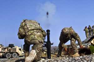 2. PAKTYA PROVINCE, Afghanistan – U.S. Army Spc. Adam L. Cayton and Spc. Sheign K. Hopson, both indirect fire infantryman with 1st Battalion, 506th Infantry Regiment, 4th Brigade Combat Team, 101st Airborne Division Air Assault), make adjustments to a 81mm mortar system during a live fire at Afghan Combat Outpost Kaligu, Afghanistan, Sept. 12, 2013.