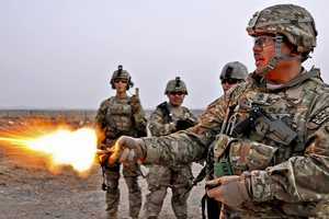 """5. Sgt. Maj. Concordio Borja Jr., from Provincial Reconstruction Team (PRT) Farah fires a handheld """"pen"""" flare with Soldiers from Nemesis Troop 4-2 Cavalry Scouts during a small-arms range training exercise on Forward Operating Base, Farah. PRT Farah's Mission is to train, advise and assist Afghan government leaders at the municipal, district and provincial levels in Farah province, Afghanistan."""