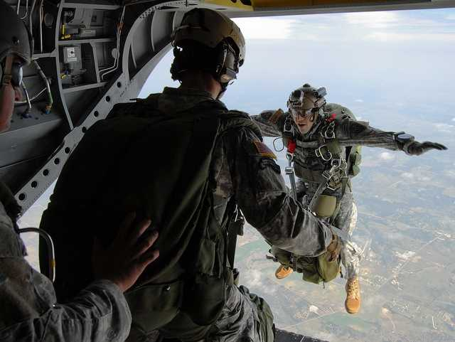 7. Staff Sgt. Adam Davila, 2nd Squadron, 38th U.S. Cavalry Regiment, exits a CH47 Chinook helicopter during a free fall jump July 29 at III Corps and Fort Hood. The Soldiers completed the jump from 12,500 feet not only to maintain proficiency, but also to follow up on wind tunnel training conducted last month.