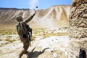 9. U.S. Army Lt. Charles Morgan, with the 6th Squadron, 4th Cavalry Regiment, 3rd Brigade Combat Team, 1st Infantry Division, throws a M67 fragmentation grenade during skills training at Kunduz province, Afghanistan, July 3, 2013.