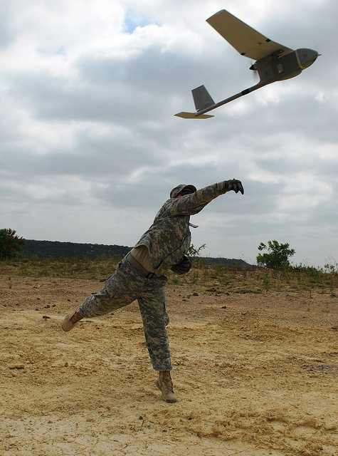 12. Spc. Ryan Dickinson, a Multiple Launch Rocket System Fire Direction Specialist with B Battery, 2nd Battalion, 20th Field Artillery Regiment, 41st Fires Brigade, throws a Raven unmanned aerial vehicle to launch it over Fort Hood, Texas, June 26. Soldiers from the 41st Fires Brigade spent two weeks learning the how to operate the raven, which is a hand-launched remote-controlled vehicle used by the Army.
