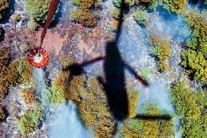 14. An Army CH-47 Chinook helicopter performs a water drop while fighting the East Peak fire near La Veta, Colo., June 21, 2013. The helicopter crew is assigned to the Colorado Army National Guard's 2nd Battalion, 135th Aviation Regiment, stationed on Buckley Air Force Base in Aurora, Colo.