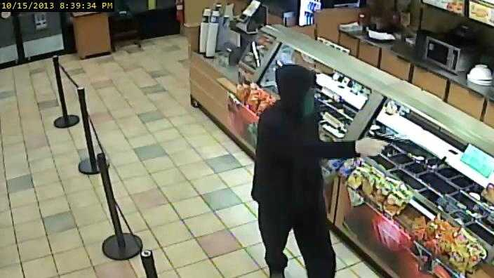 Police released this surveillance photo of the man accused in the robbery.