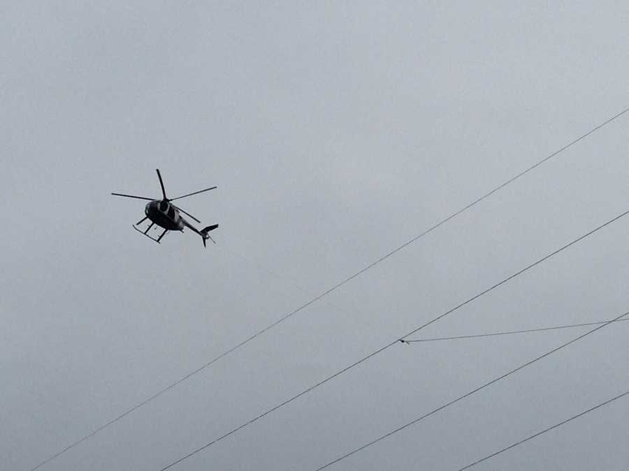 Choppers are pulling ropes over the roadway in East Hempfield Township so power lines can be pulled across and connected.