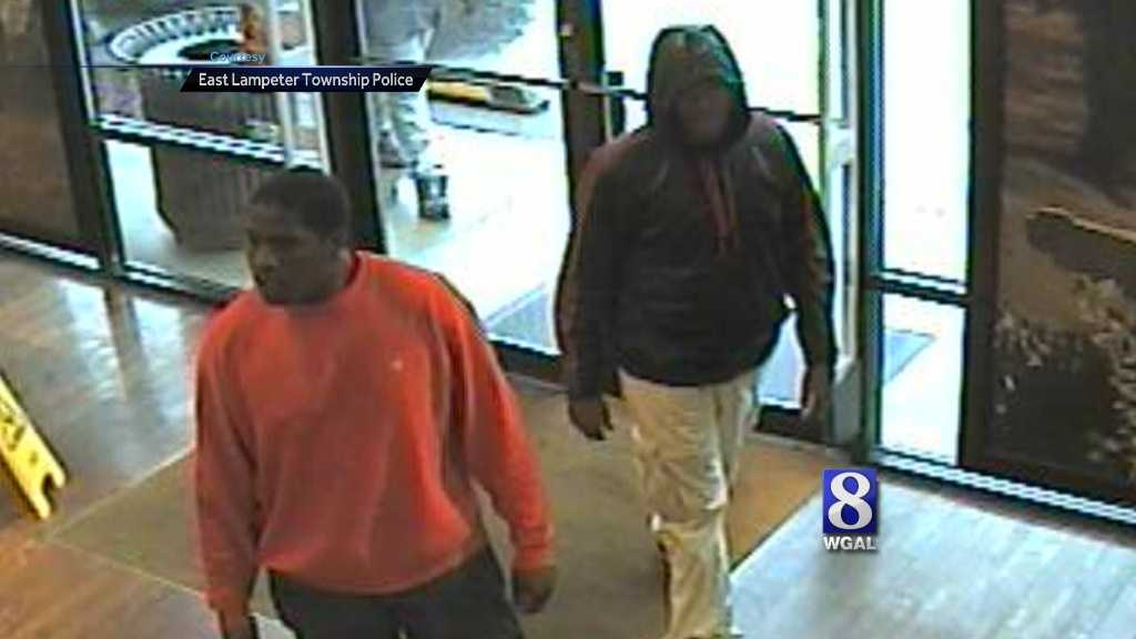 Police released this surveillance camera image of two of the men accused in the robberies.