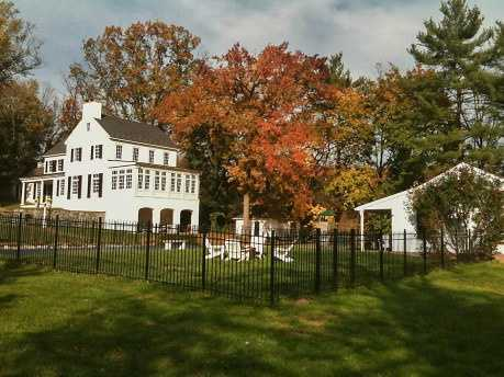This Lancaster home is located on a picturesque eight acres with a beautiful wooded surrounding.