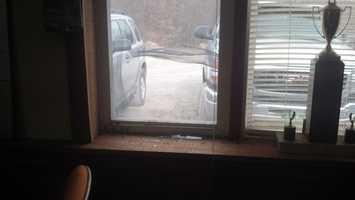 He broke this window to get inside.