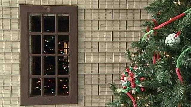 The house is 12 feet tall and covered in more than 32 different Hershey products.