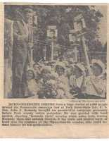 A newspaper clipping shows Kennedy's visit.