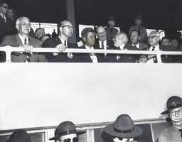 Here, Kennedy can be seen sitting in the grandstands at the York Fair.