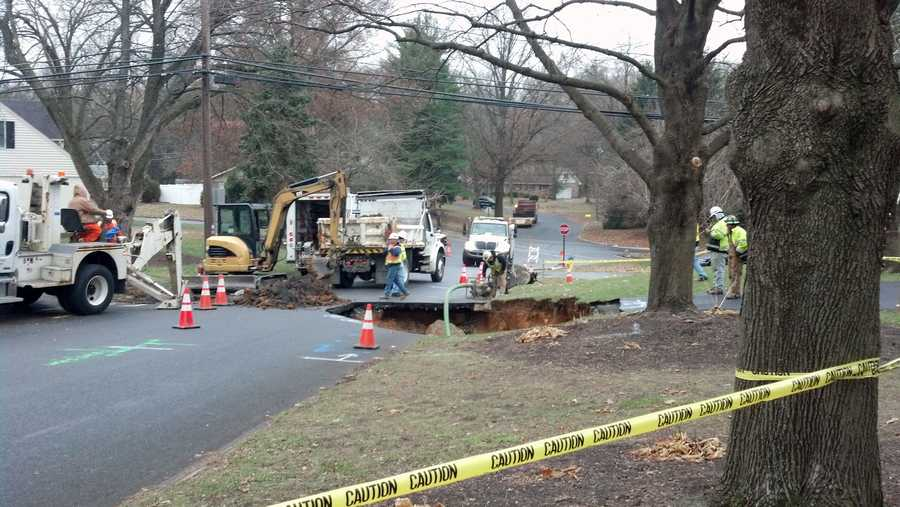 The sinkhole opened early Tuesday at the end of a driveway in the 400 block of Deerfield Road.