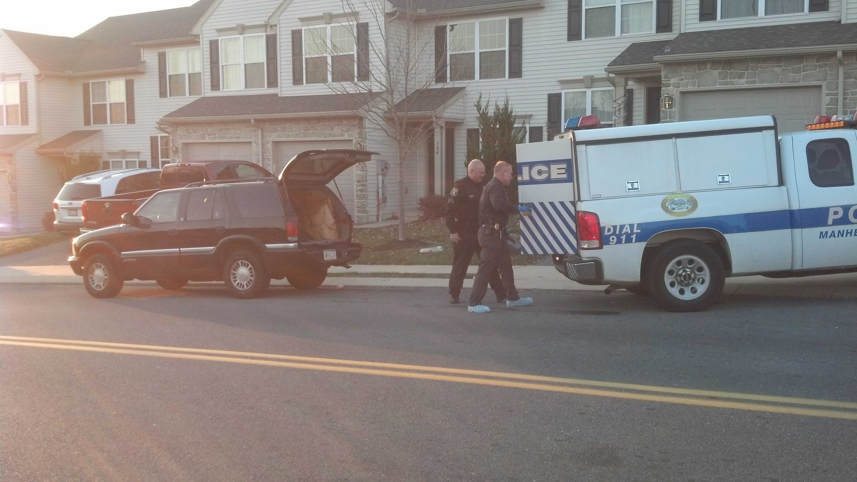 Police remove evidence bags from the home on Friday.