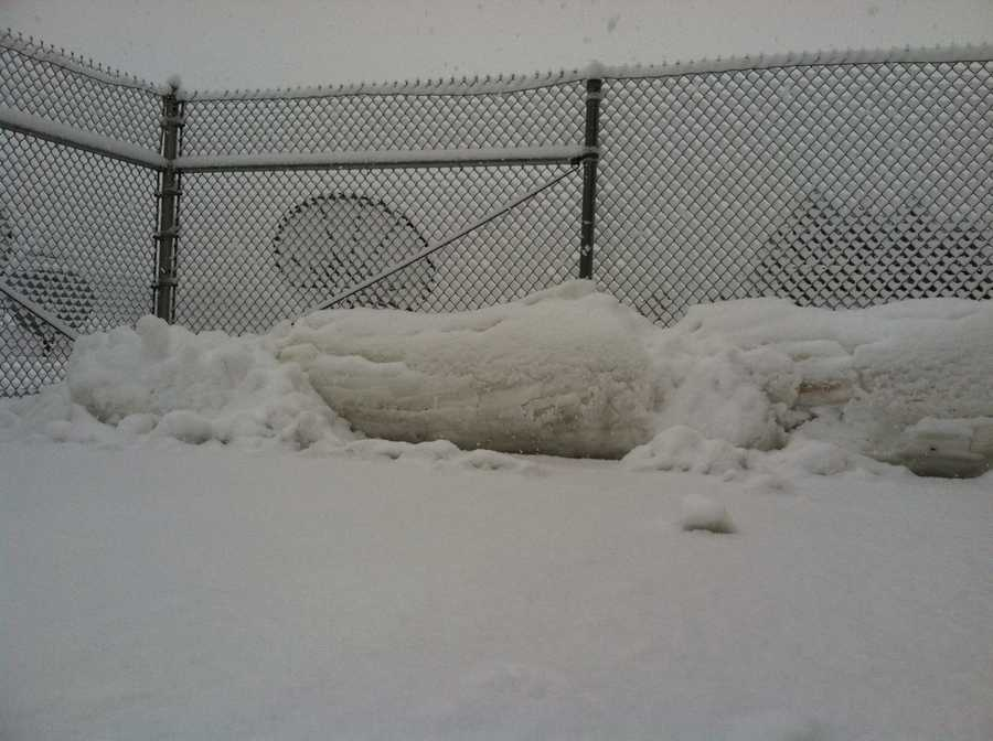 Plowed snow piles up in WGAL's parking lot.